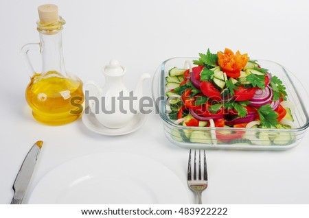 Vegetable salad and olive oil.
