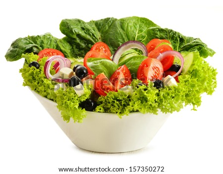 Vegetable salad bowl isolated on white - stock photo