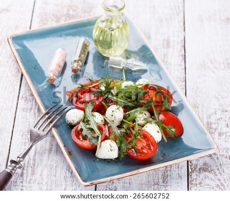 Vegetable salad,cherry tomatoes,, mini mozzarella, arugula. selective focus - stock photo