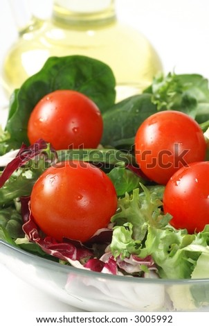 Vegetable salad in a bowl and oil
