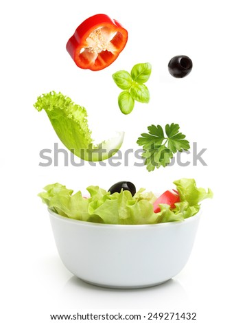 Vegetable salad in bowl isolated on white.  - stock photo