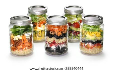 vegetable salad in glass jar on white background  - stock photo