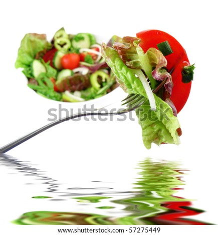 vegetable salad on a fork and mirroring - stock photo