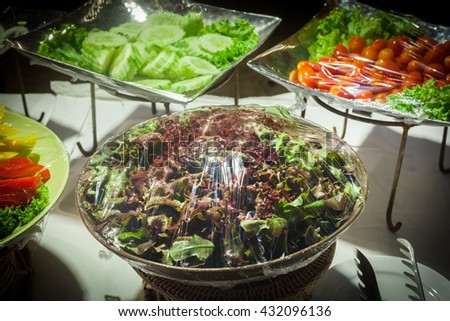 Vegetable salad on plastic wrap for buffet line in wedding party.