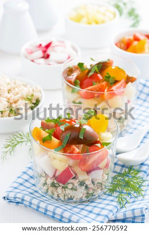 vegetable salad with cottage cheese in a glass, vertical - stock photo