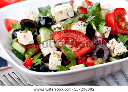 vegetable salad with feta cheese - stock photo