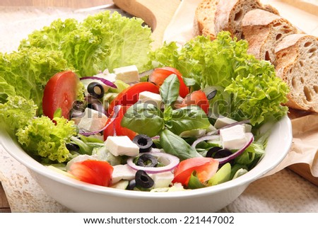 Vegetable salad with feta cheese and black olives - stock photo