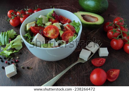 Vegetable sald in a bowl on wooden table
