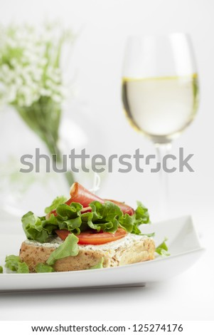 Vegetable Sandwich with champagne on a blurred background