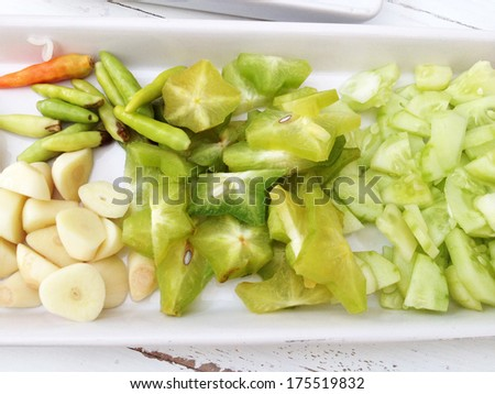 Vegetable side dishes, cutted of star apple, garlic, chilli, raw banana, cucumber, Fresh vegetable  - stock photo