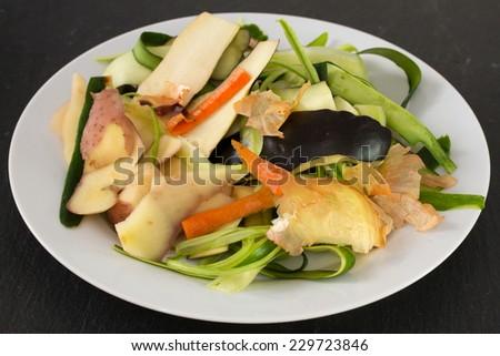 vegetable skin in white dish - stock photo