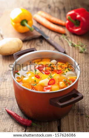 vegetable soup in red pot  - stock photo