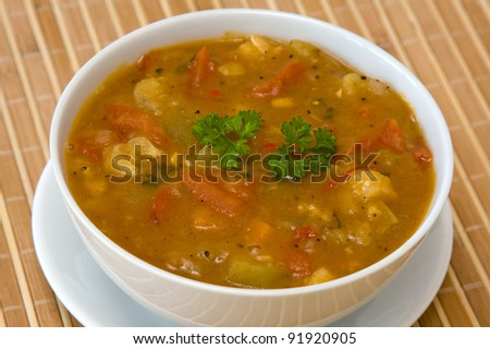 Vegetable soup on white plate - stock photo