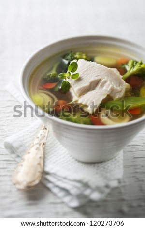 Vegetable soup with chicken meat close up - stock photo