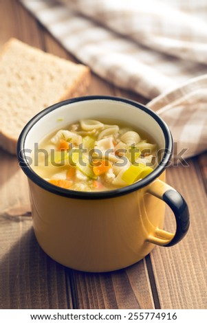 vegetable soup with pasta in cup - stock photo