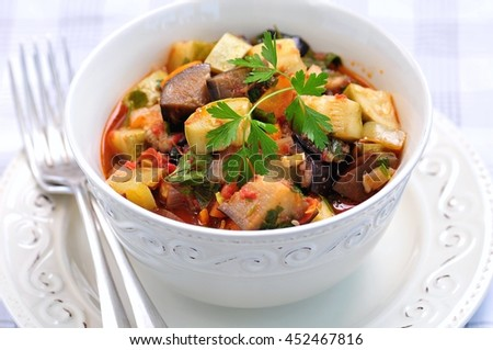 Vegetable stew of eggplant, zucchini, onions, carrots, tomatoes, garlic and parsley