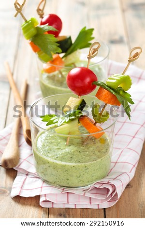 Vegetable sticks and green cold soup (gazpacho) .   - stock photo
