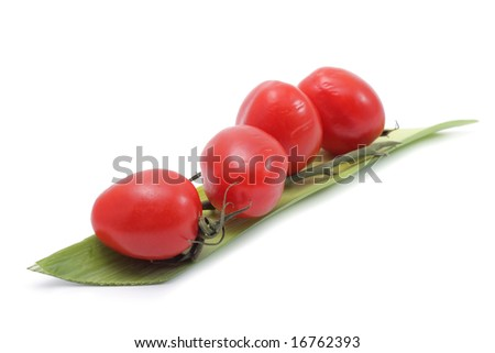 Vegetable still life of cherry tomato and salad. Isolated on a white background