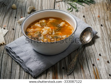 Vegetable vegetarian soup made of cabbage, corn, green bean, peas, carrots, cauliflower, green bell pepper, tomato and leek in a bowl/ Selective Focus - stock photo
