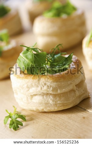 Vegetable Vol au Vent on a wooden serving board