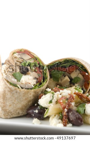 Vegetable wraps on a plate. Shallow DOF. Focus on right wrap. - stock photo