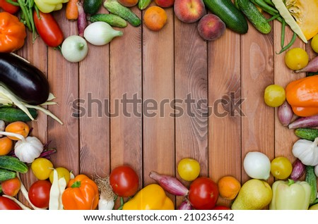 vegetables and fruits composition on wooden table - stock photo