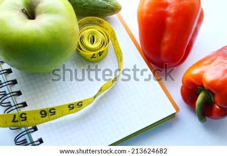 vegetables and fruits for weight loss, a measuring tape, diet, weight loss - stock photo