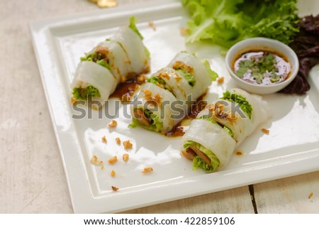 Vegetables and in noodle tube.Portion of spring rolls with spicy.