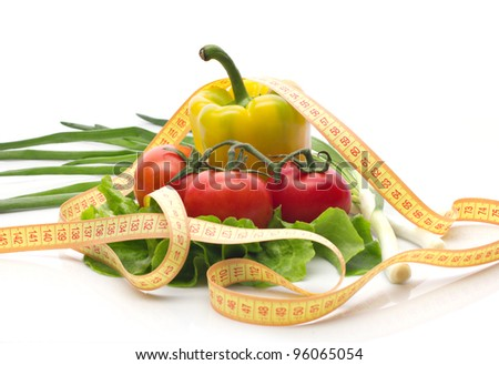 Vegetables and measuring tape, still life isolated on white