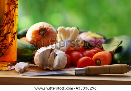 vegetables and oliveoil on wooden table - stock photo