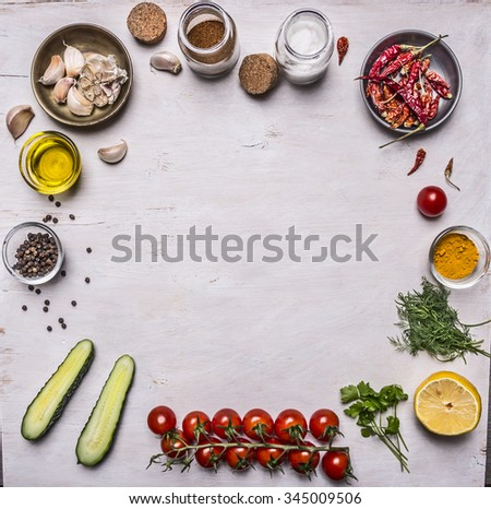 vegetables and seasonings, frame laid out on a white wooden background  top view
