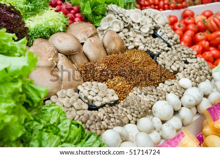Vegetables and various mushrooms in supermarket - stock photo