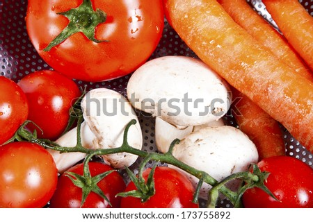 Vegetables are put in a kitchen sink for washing - stock photo
