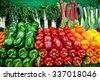 Vegetables at a market- different peppers - stock photo