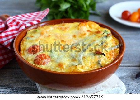 Vegetables baked with cheese in a pan, food closeup
