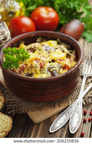 Vegetables baked with cheese in the pot on the table