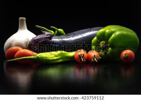 Vegetables, eggplant, bell pepper, green pepper, tomato, garlic, close-up, macro. - stock photo