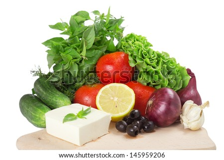 Vegetables for salad isolated on white background