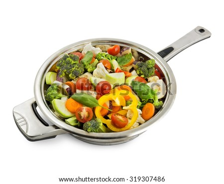 Vegetables in a frying pan isolated on white background with shadow - stock photo