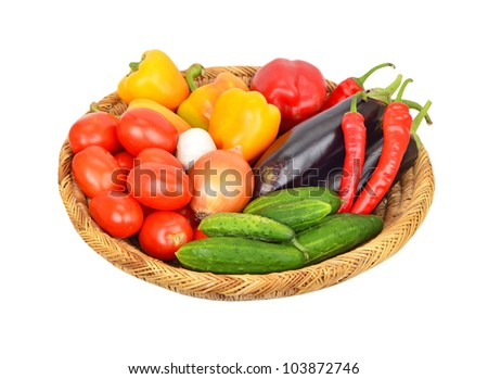 Vegetables in a wattled basket, isolated on white background - stock photo