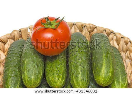 vegetables in basket on a grass,cucumbers and tomatoes in the basket,the basket of vegetables,juicy ripe vegetables - stock photo
