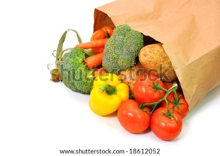 Vegetables in grocery bag isolated on white background. - stock photo