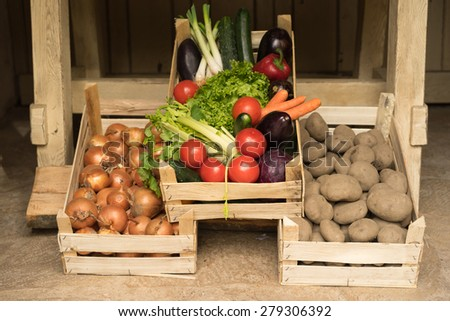 Vegetables in wooden boxes