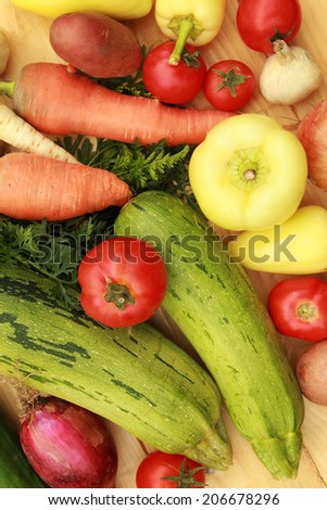Vegetables Mixed vegetables on wooden table - stock photo