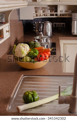 Vegetables near the casseroles in the kitchen, cooking concept - stock photo