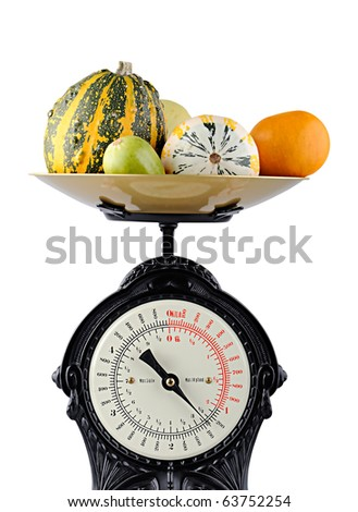vegetables on a kitchen food scale - stock photo