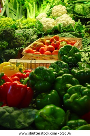 vegetables on a market stand (slightly shallow depth of field, focus is on tomatoes) - stock photo