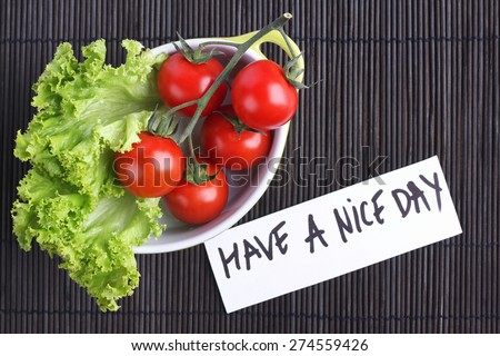 Vegetables on the table. Diet food. Weight lose. Organic vegetables. The cherry tomatoes on a branch. Red tomatoes on a branch, lettuce. Vegetable Breakfast. Fresh vegetables. Vegetables in the pan. - stock photo