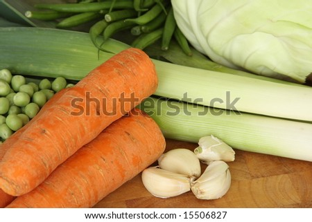 Vegetables over a cutting table close up - stock photo