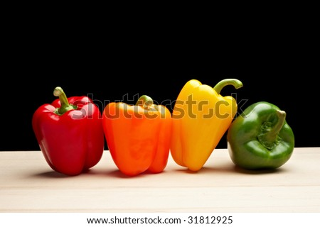 Vegetables - Peppers on black background - stock photo